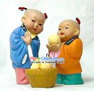 Beijing Hand Made Clay Statue-Kids Giving The Bigger Pear to Others